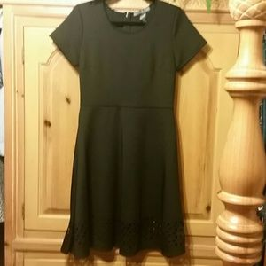 Black dress with cut outs on the bottom